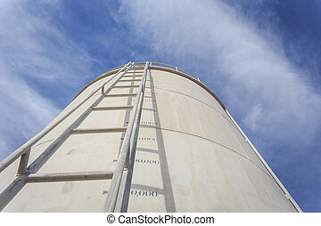 High steel ladder on big water tank
