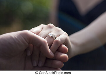 Close Up Holding Hands with Engagement Ring - Engaged male ...