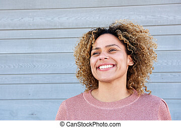 Close up horizontal beautiful african american woman smiling against gray background