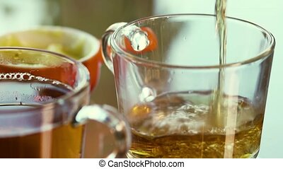 Hot Delicious Aromatic Tea Is Poured Into A Glass Mug -...