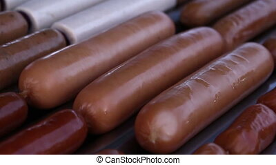hotdog on grill machine