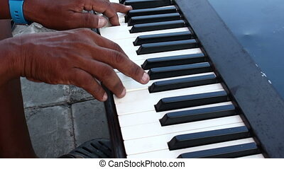 human hand playing Electric piano - close up human hand...