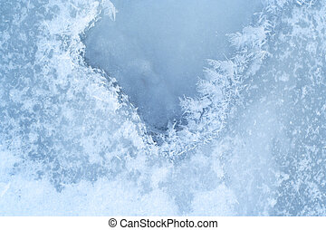 close-up ice-bound water surface with crystals pattern at...