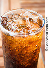 Close up ice cubes on cola glass