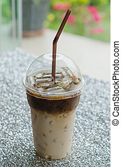 Iced coffee - close up Iced coffee with straw in plastic cup...