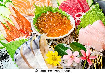 Close up ikura (salmon roe) in sashimi set. - Close up ikura...