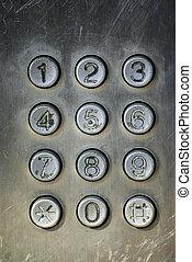 Close up image of a public pay phone keypad