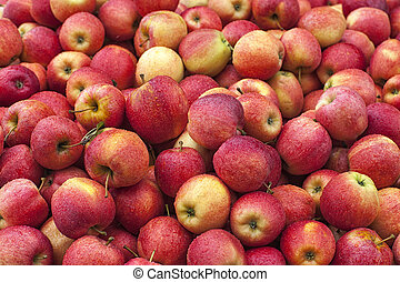 a stack of red apples