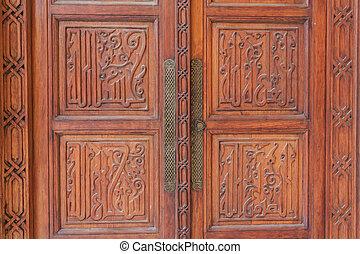 Close-up image of ancient wooden door