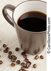 black coffee with coffee beans - Close up image of black...