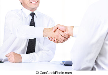 Close up image of business handshake in the meeting.