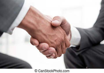Close-up image of business partners shaking hands