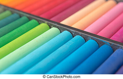 Close-up image of colorful chalk pastels in wooden box