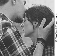 Close-up image of couple in love. Black-white photo.