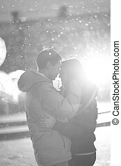 Close-up image of couple in love, man kisses a woman. Used filters instagram Black-white photo.