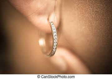 Close up image of female ear