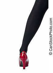 female leg with black stocking and red shoes