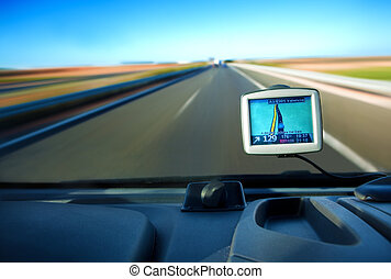 gps - Close up image of gps in a car and road