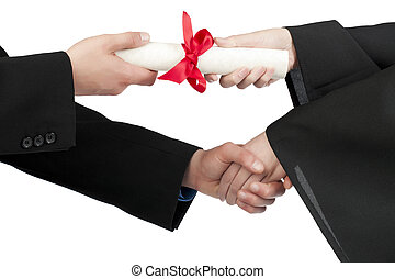 Close up image of graduating student hand accepting diploma against against white background