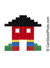 Close up image of house made of colorful lego blocks against white background