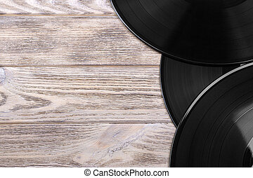 Close up image of old vinyl records over wooden background with copy space