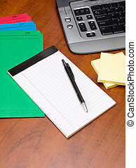 close up image of pen and notepad with files on office desk