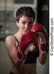 close-up image of pretty female standing in boxing pose