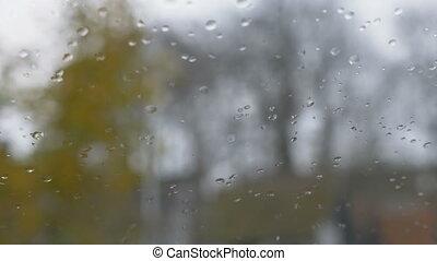 close up image of rain drops falling on a window