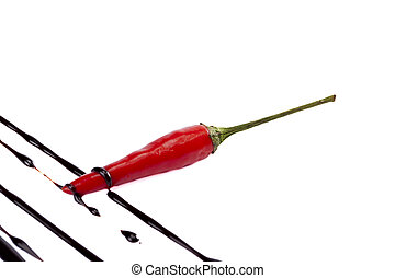 red chili with chocolate drip