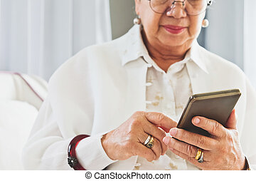 Senior woman using her mobile phone