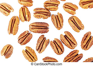 Close-up image of several pecan nuts scattered on a white surface