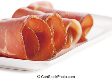 slices of cooked ham