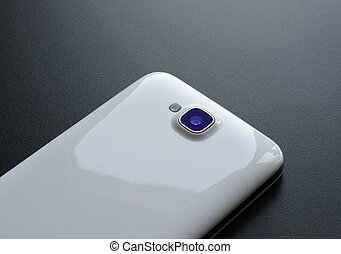 Close Up Image of the Camera of White Smart Phone on the Black Table