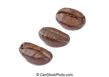 close up image of three coffee beans