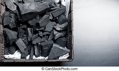 Close-up images of charcoal on black background