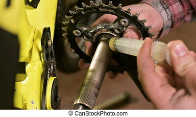 Close-up in a workshop repairing bicycles the master...