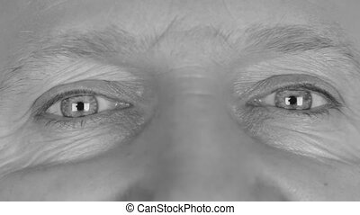 Close-up in black and white on man's eyes, smiling eyes. HD