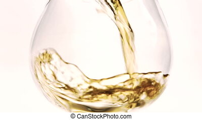 Close-up in glass goblet is poured brown liquid. On white...