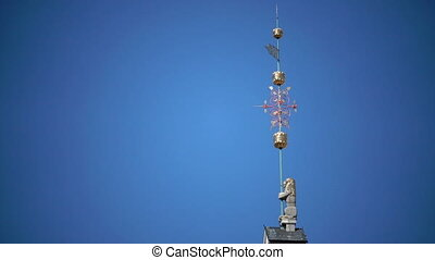 Close up in sunny day against the background of the blue sky of a weather vane on the Town hall Tallinn Estonia