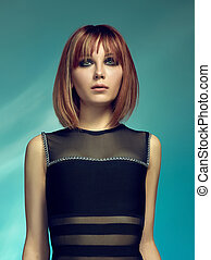 Close-up indoor portrait of lovely girl with colorful hair. Studio shot of graceful young woman with short haircut