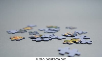Falling Down Randomly Puzzles Filling the Shotframe. Beginning Business. Work to Do. Hobby. Jigsaw Puzzle Pieces Falling Down on Grey Background. Parts of the whole. Assembling Puzzle Game. Pastime