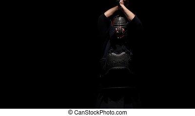 Close-up Kendo guru practicing martial art with the Katana...