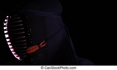 Close-up Kendo guru sitting on the floor in an traditional...
