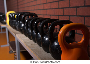 Close up kettlebells in the gym on a brick