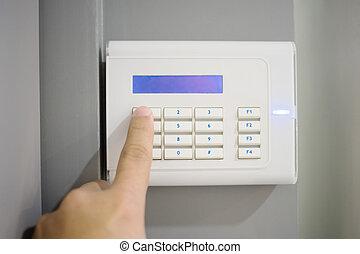 close-up, kode, keypad, alarm, hånd, person, indgå, security til hjem