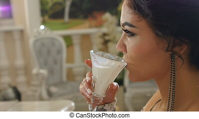 close up lady drinks milk in slow motion