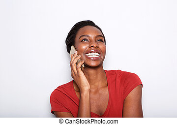 Close up laughing black woman talking on phone isolated on white background