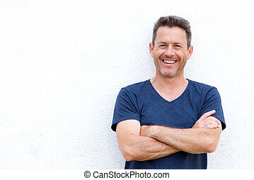 Close up laughing casual man standing with arms crossed