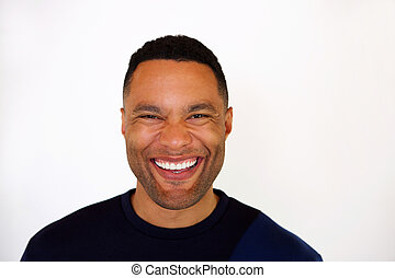 Close up laughing young african man against white background