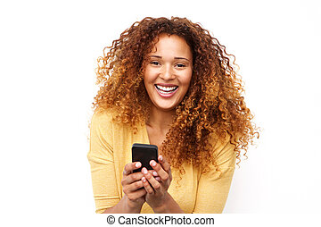 Close up laughing young woman with mobile phone against white background